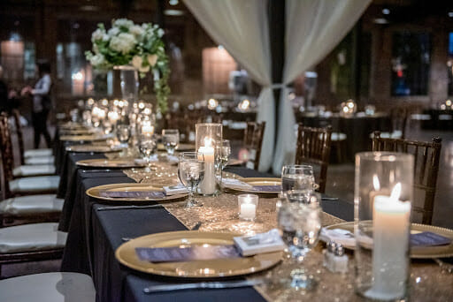 A closeup shot of an elegant wedding table setting in the hall